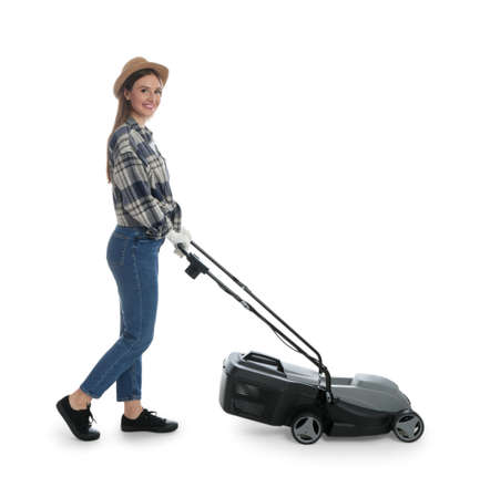 Young woman with modern lawn mower on white background Imagens