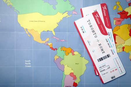 Tickets on world map, flat lay. Travel agency concept Reklamní fotografie