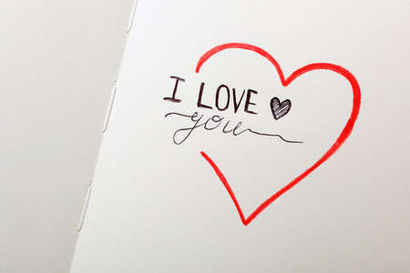 Phrase I Love You and heart drawings on notebook page Standard-Bild