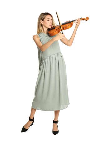 Beautiful woman playing violin on white background Standard-Bild