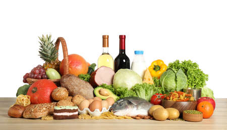 Different products on wooden table. Healthy food and balanced diet