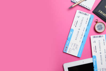 Flat lay composition with tickets on pink background, space for text. Travel agency concept Reklamní fotografie
