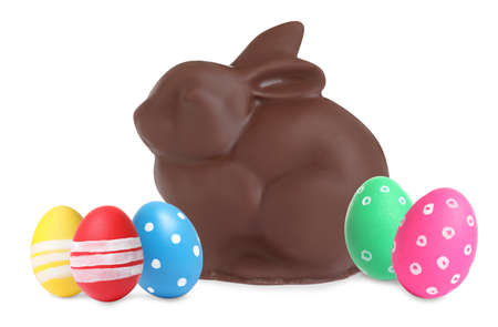 Chocolate bunny and painted Easter eggs on white background