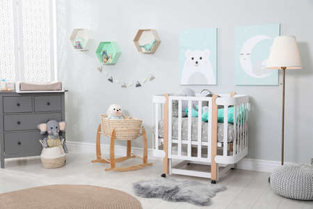 Cozy baby room with crib and other furniture. Interior design Standard-Bild