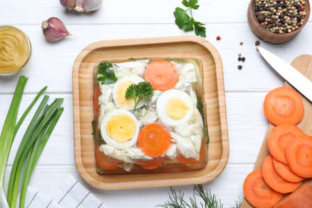 Delicious fish aspic served on white wooden table, flat lay