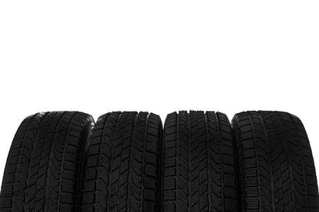 Set of new winter tires on white background, closeup