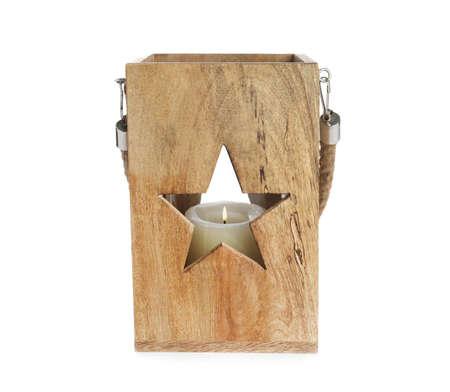 Wooden Christmas lantern with burning candle isolated on white