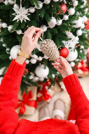 Woman decorating Christmas tree at home, top view Banco de Imagens