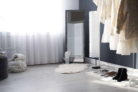 Dressing room interior with clothing rack and mirror Stock Photo