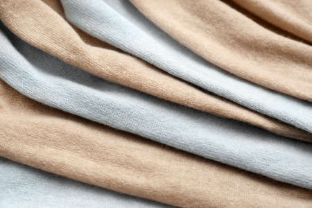 Different cashmere clothes as background, closeup view