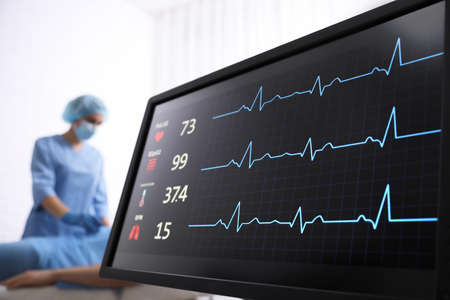 Cardiogram and data on display of heart rate monitor in clinic
