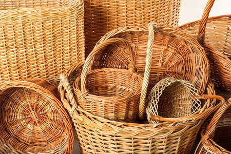 Many different wicker baskets made of natural material as background