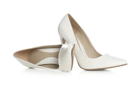 Beautiful classic wedding shoes on white background Stock fotó