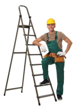 Professional constructor near ladder on white background