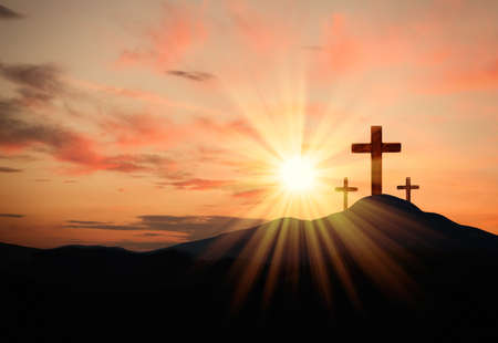 Christian crosses on hill outdoors at sunset. Crucifixion Of Jesus
