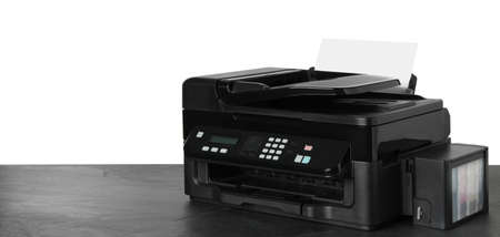 New modern multifunction printer on grey table