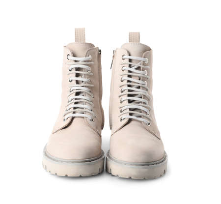 Pair of stylish boots on white background