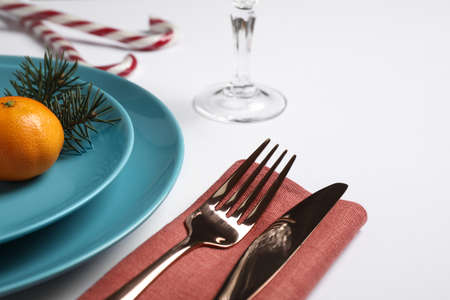 Beautiful Christmas table setting on white background, closeup Reklamní fotografie