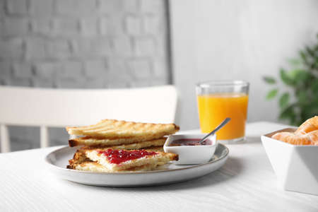 Tasty toasts with jam served on white wooden table indoors. Space for text Reklamní fotografie
