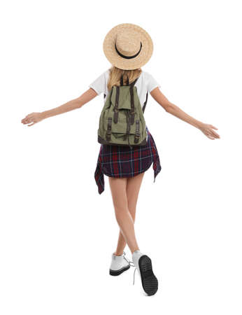 Woman with backpack and straw hat on white background, back view. Summer travel 版權商用圖片
