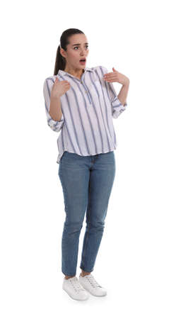 Shocked woman pointing at herself on white background 版權商用圖片