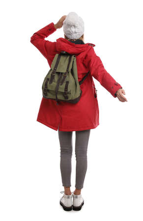 Woman with backpack on white background, back view. Winter travel 版權商用圖片