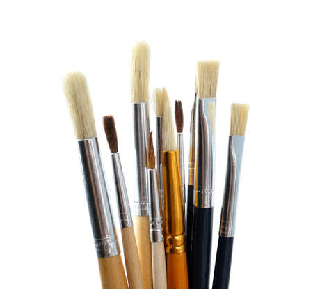 Set of different paint brushes on white background