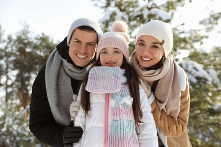 Happy family outdoors on winter day. Christmas vacation