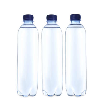 Plastic bottles with water on table against white background Archivio Fotografico