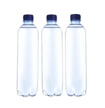 Plastic bottles with water on table against white background Reklamní fotografie