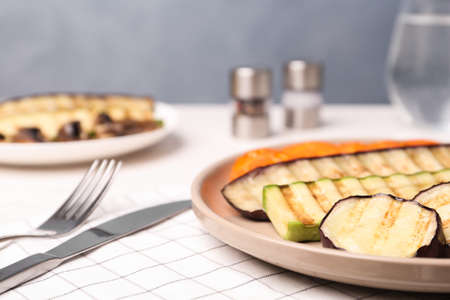 Delicious grilled vegetables served on table, closeup. Space for text