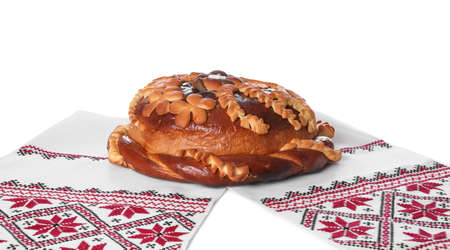 Rushnyk with korovai on white background. Ukrainian bread and salt welcoming tradition