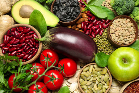 Different vegetables, seeds and fruits as background, closeup. Healthy diet