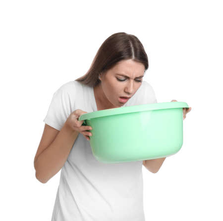 Woman with basin suffering from nausea on white background. Food poisoning Stockfoto