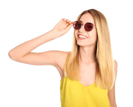 Beautiful woman in stylish sunglasses on white background