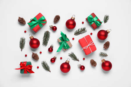 Flat lay composition with gift boxes and Christmas decor on white background 版權商用圖片