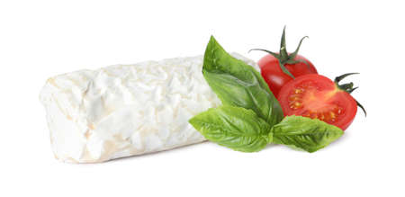 Delicious fresh goat cheese with basil and cherry tomatoes on white background