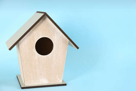 Beautiful bird house on light blue background, space for text Banque d'images