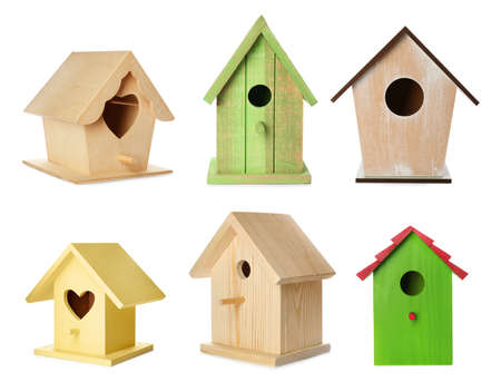 Set with different beautiful bird houses on white background