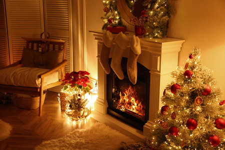 Fireplace with Christmas stockings in beautifully decorated living room