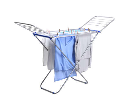 Clean laundry hanging on drying rack against white background