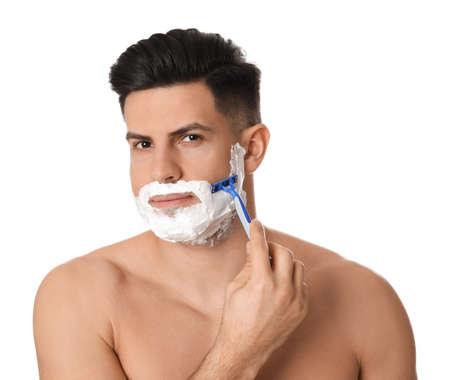 Handsome man shaving with razor on white background Stock Photo