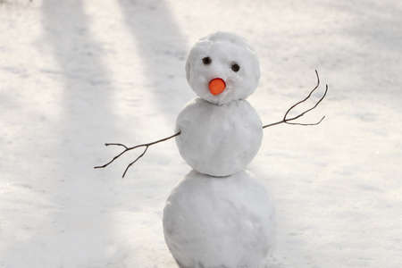 Funny snowman with carrot nose outdoors on winter day Zdjęcie Seryjne