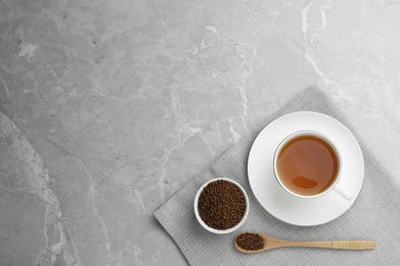 Buckwheat tea and granules on light grey marble table, flat lay. Space for text Stock Photo