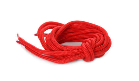 Red shoe laces tied in knot isolated on white