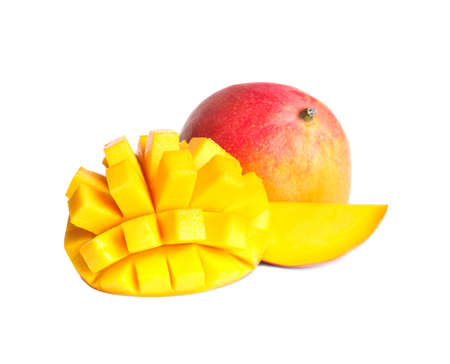 Delicious whole and cut mangoes on white background