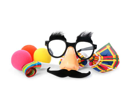 Different funny clown's accessories on white background