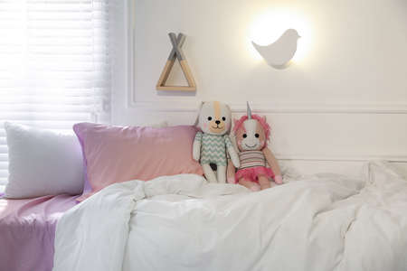 Bird shaped night lamp on wall in child's room