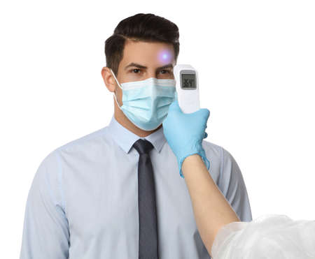 Doctor measuring man's temperature on white background, closeup. Prevent spreading of Covid-19