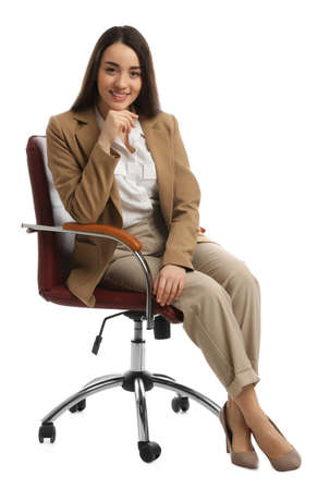 Young businesswoman sitting in comfortable office chair on white background Banque d'images